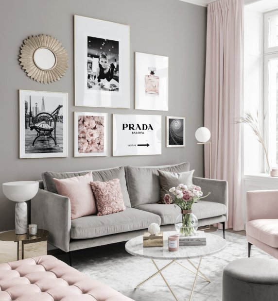 Fashionable gallery wall black white posters pink tones golden frames