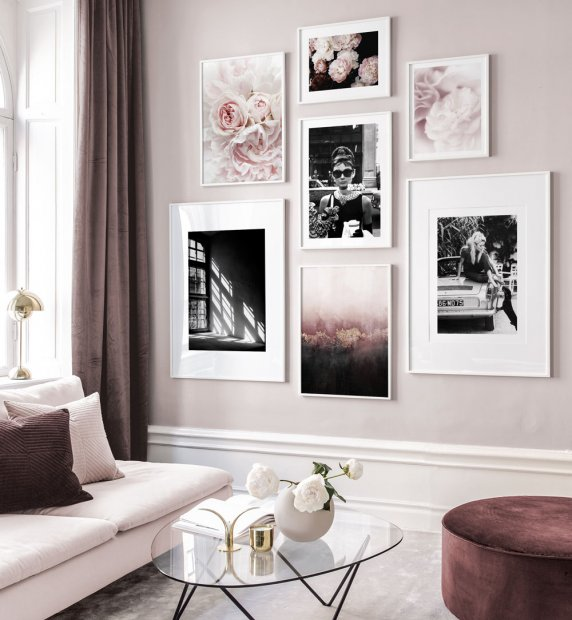 Pink gallery wall with elegant motifs and white frames
