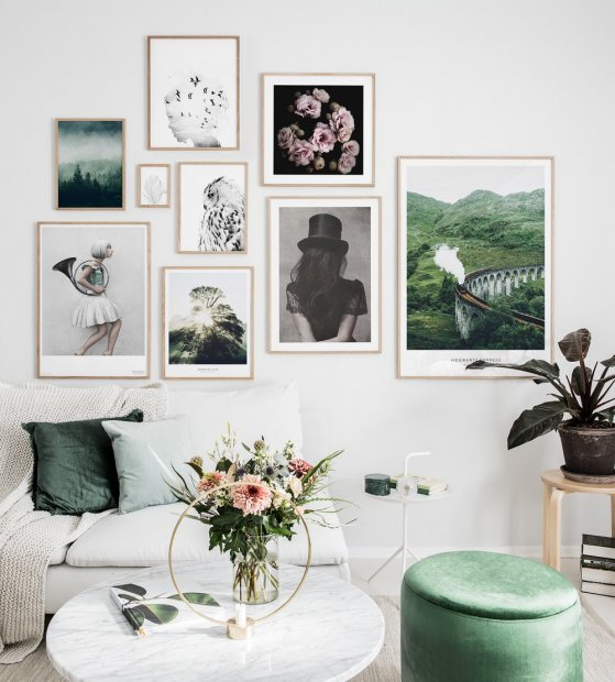 Stylish gallery wall with oak frames and inspiring posters