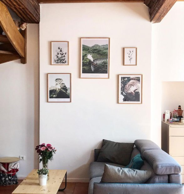 Gallery wall with botanical prints in oaken frames