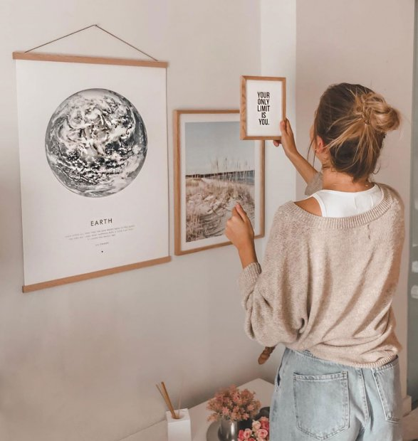 Gallery wall with Earth poster in oaken poster hanger