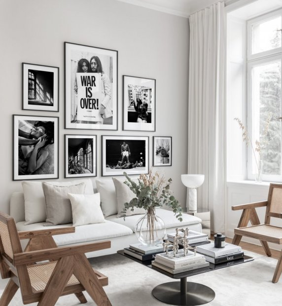 Gallery wall in black and white with iconic photo posters and black frames