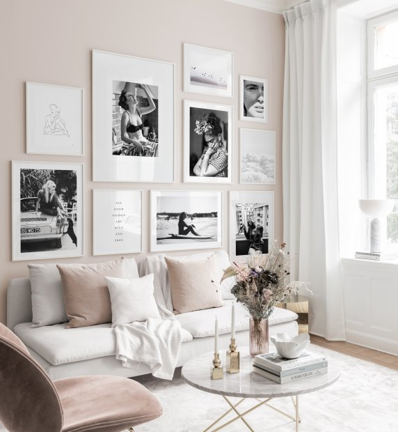 Gallery wall with white wooden frames and black and white posters