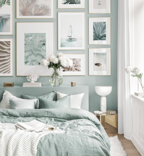 Summery gallery wall blue bedroom nature posters golden frames
