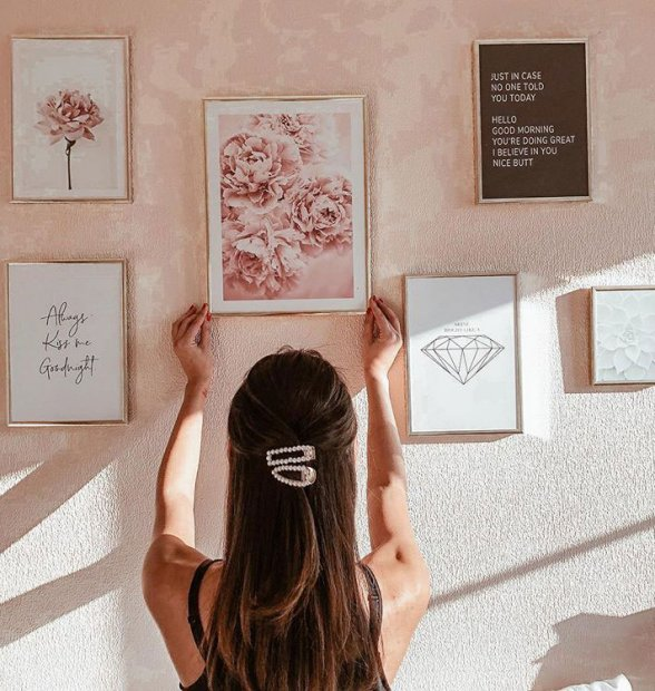 Colourful gallery wall with pink flowers and quotes prints